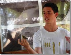 young bird expert holding bird article