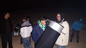 jomata and yuongster with telescope
